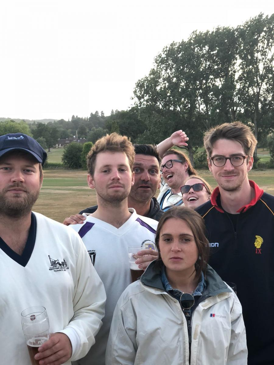 Some of the first team celebrate, photobombed by the club skipper and some other people trying not to hide at the back
